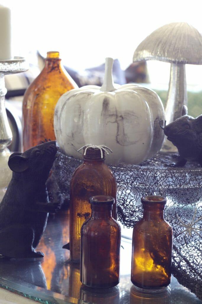 Amber bottles on Halloween Table