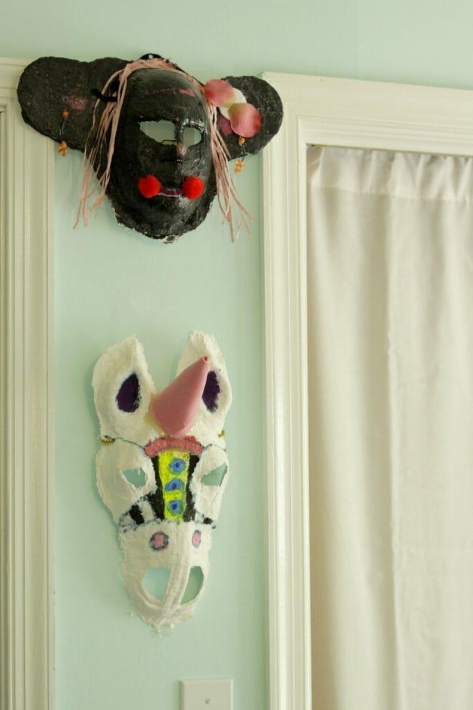 Handmade child's masks in bedroom