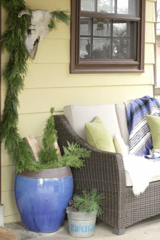 bohemian-christmas-porch-greenery-and-blues