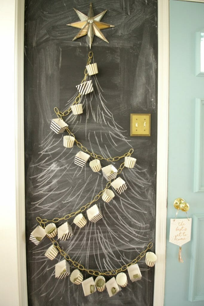 DIY Advent Calendar with chains and treat boxes on chalkboard wall
