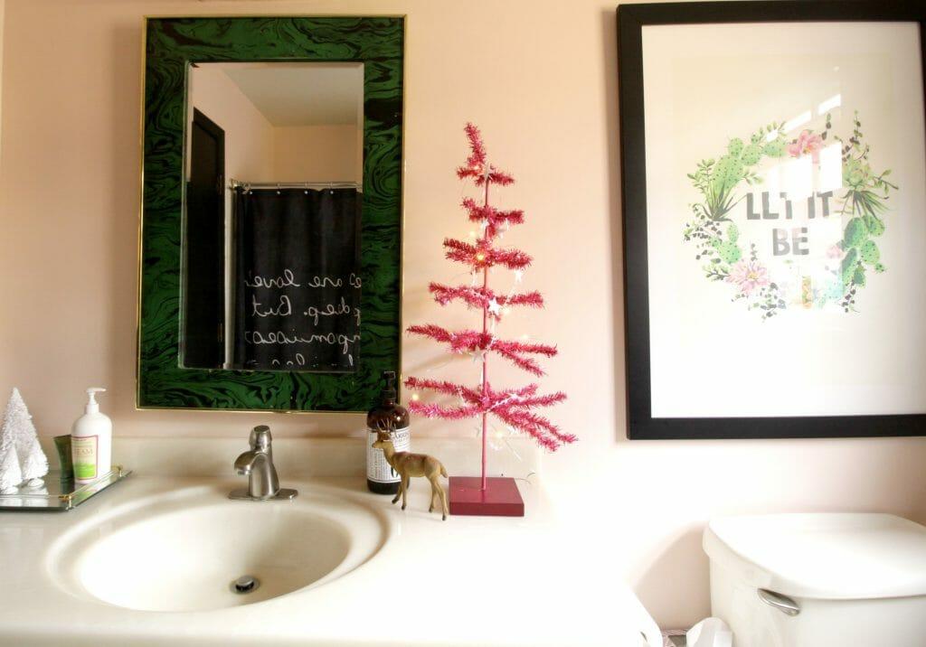 Pink tinsel tree in bathroom