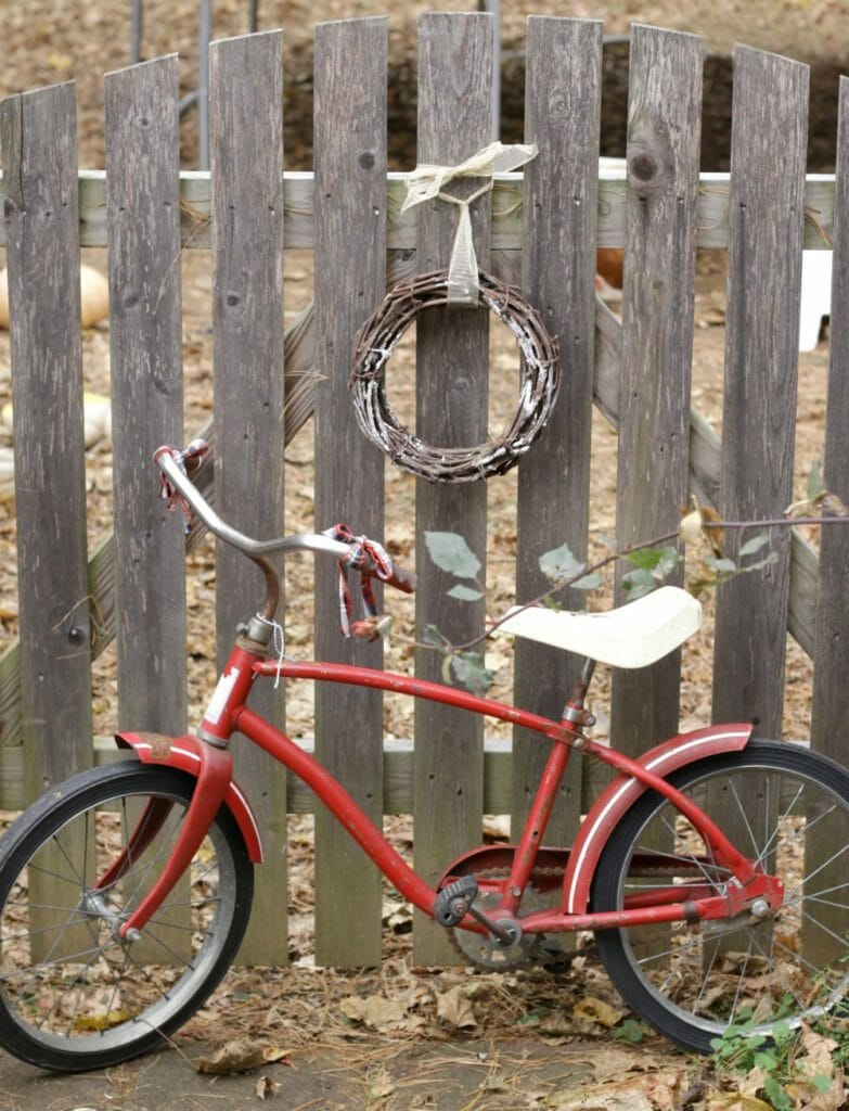 vintage-red-bike-at-gate