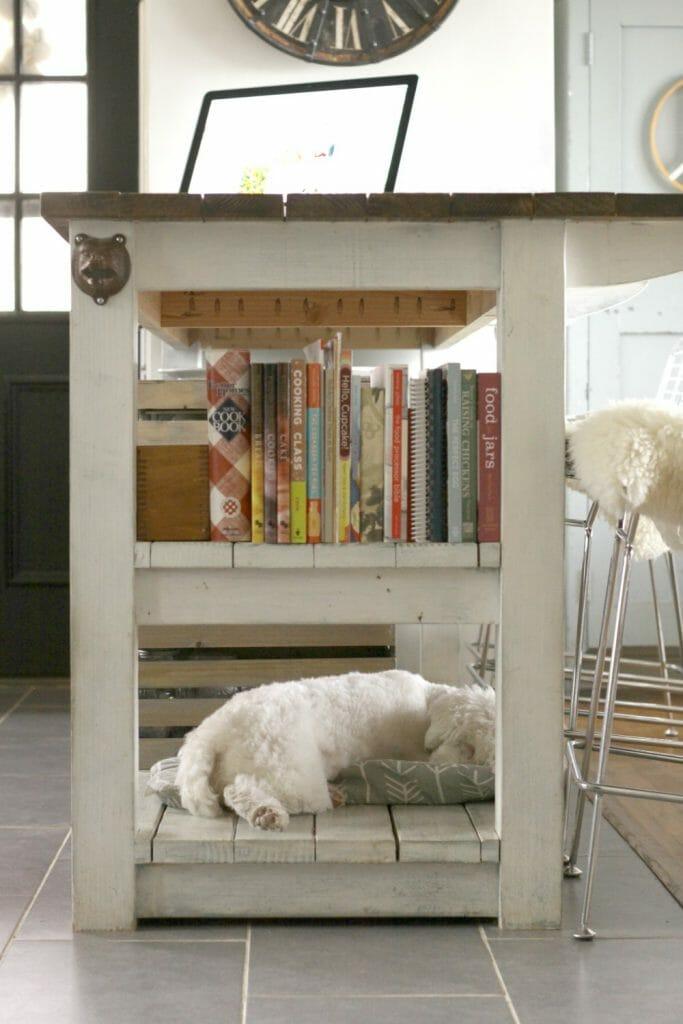 Snowbvall on the island; dog bed on kitchen island