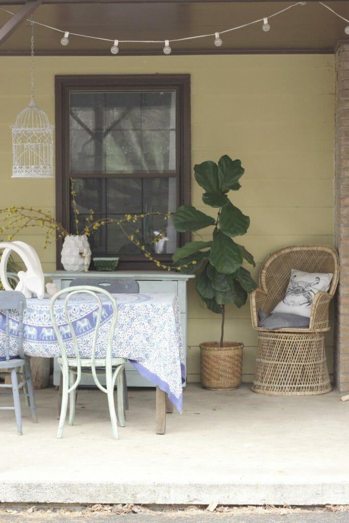 Vintage Peacock Wicker Chair as Boho Porch Decor