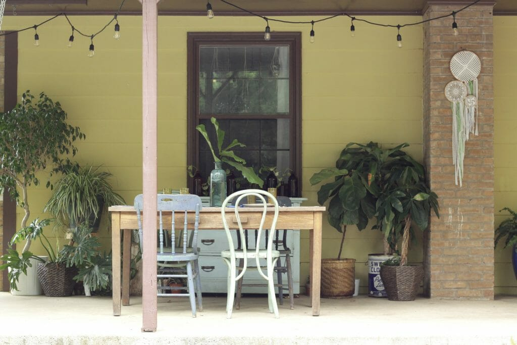 Bohemian Porch Dining with string lights