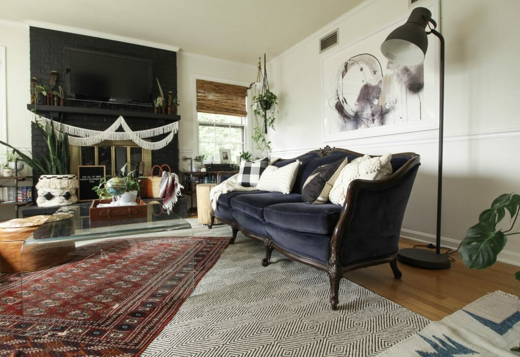 Navy Vintage Sofa in fall living room- layered rugs