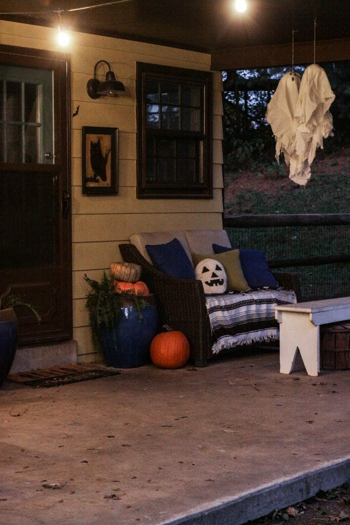 Hanging ghosts as halloween porch decor