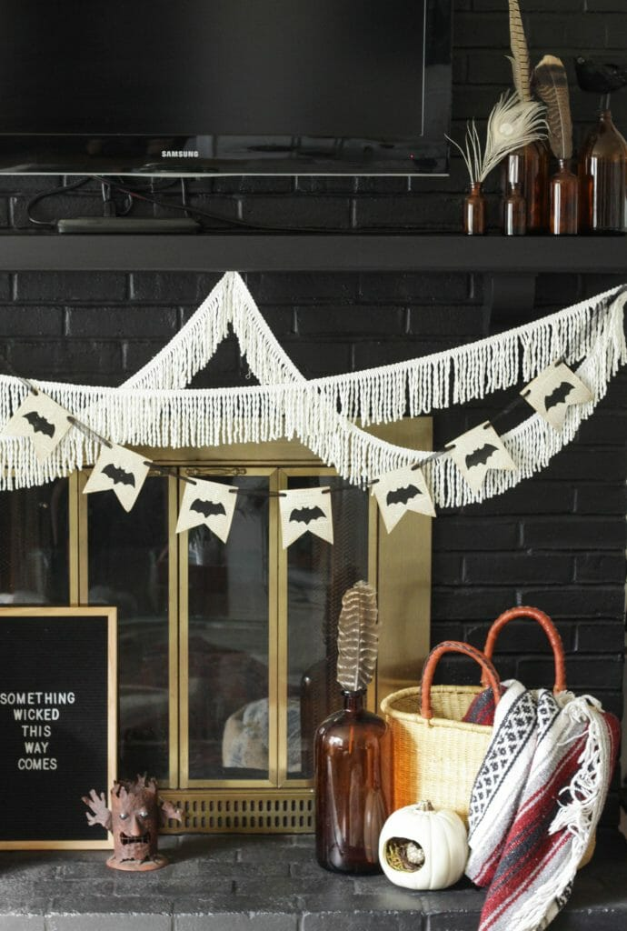 DIY Bat banner on fireplace for Halloween