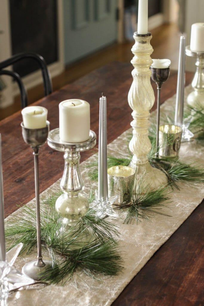 Mix of candlesticks as Christmas centerpiece