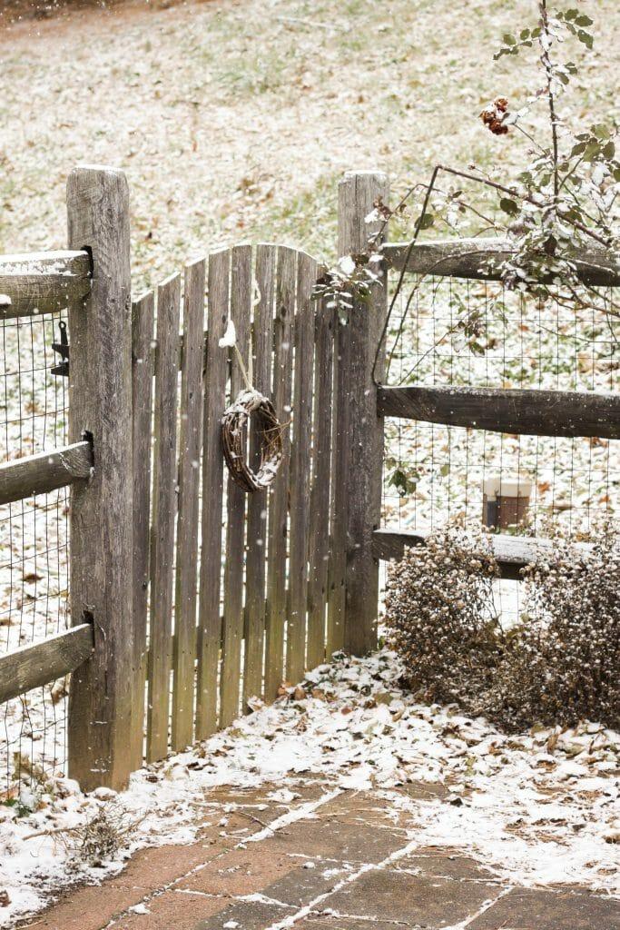 Snowy gate with wreath