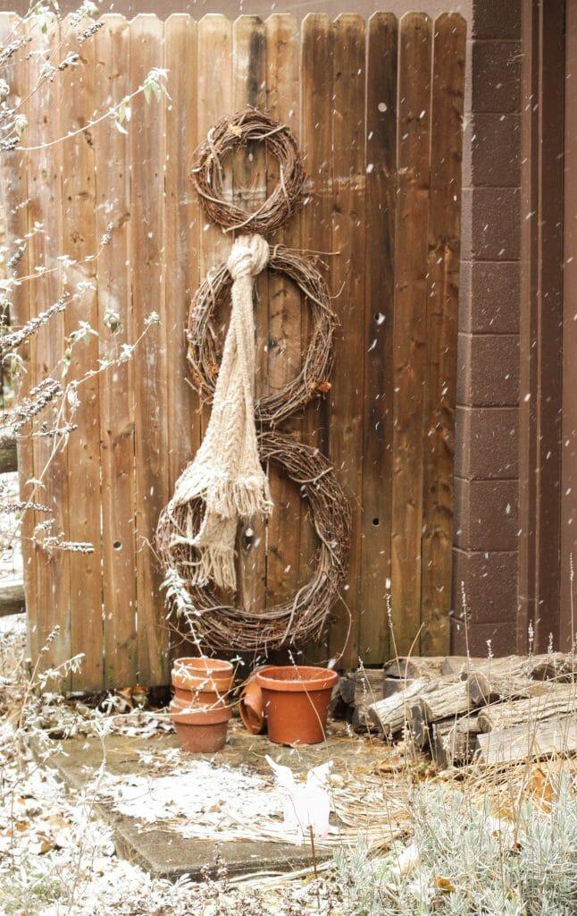 Wreath Snowman on fence