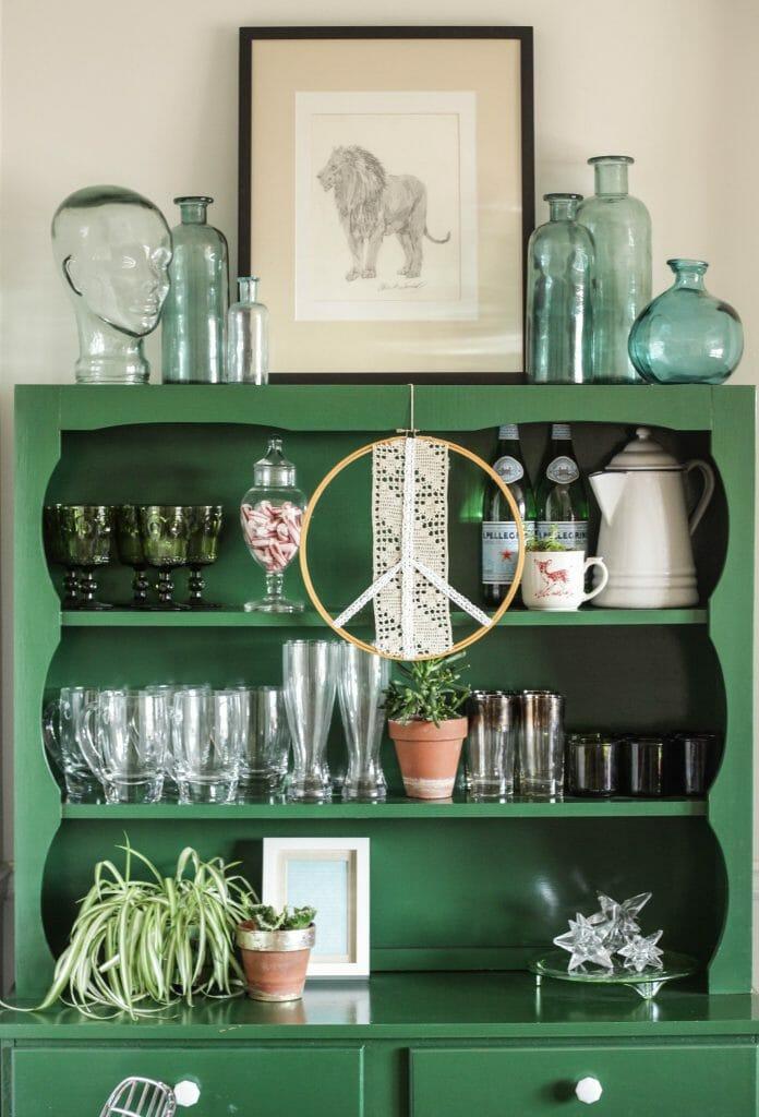 Green hutch shelfie styled with aqua glass