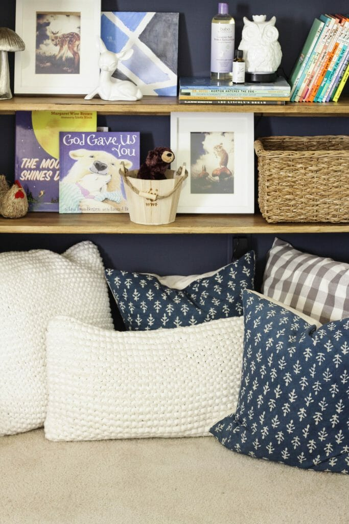 Pillows in little reading nook in nursery