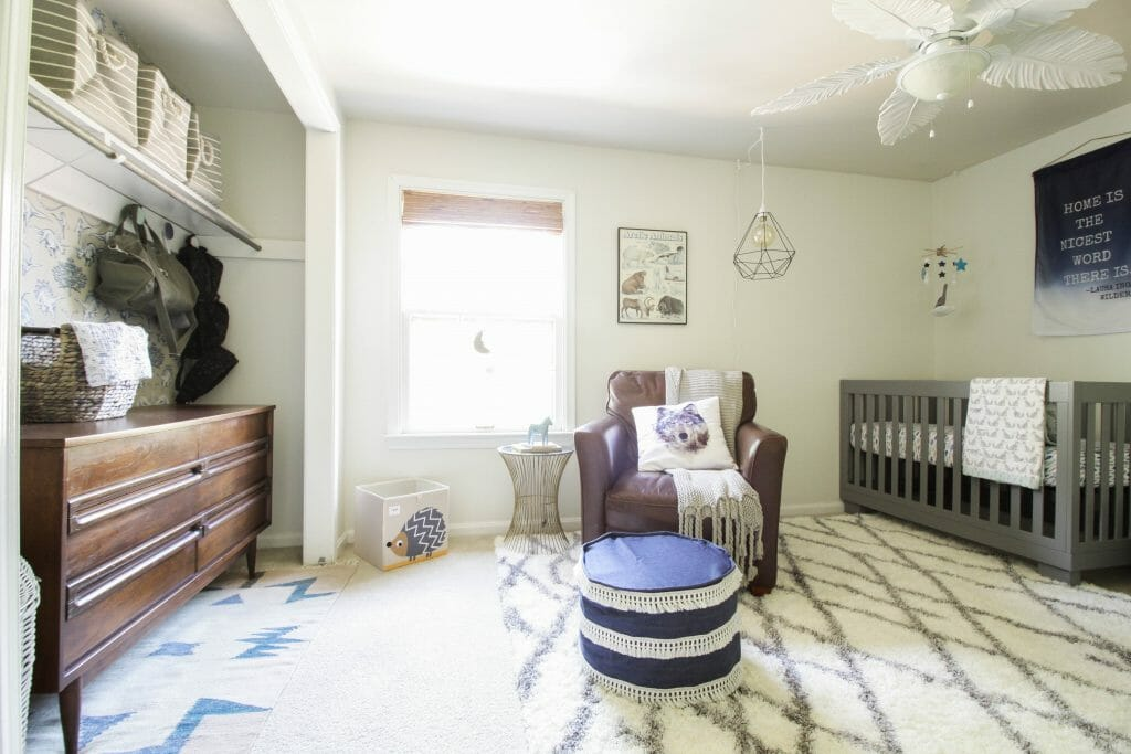 boys nursery in blue white gray featuring wallpapered closet