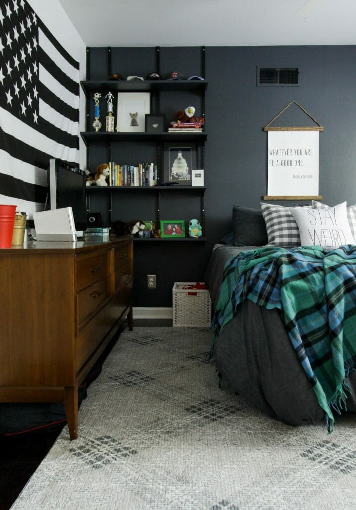 moody teen boy bedroom with touches of plaid and track shelving