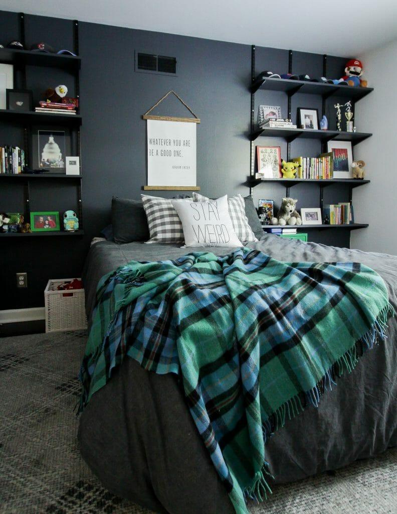 moody teen boy bedroom with touches of plaid #pbteen #plaidblanket #teenbedroom #teenroom