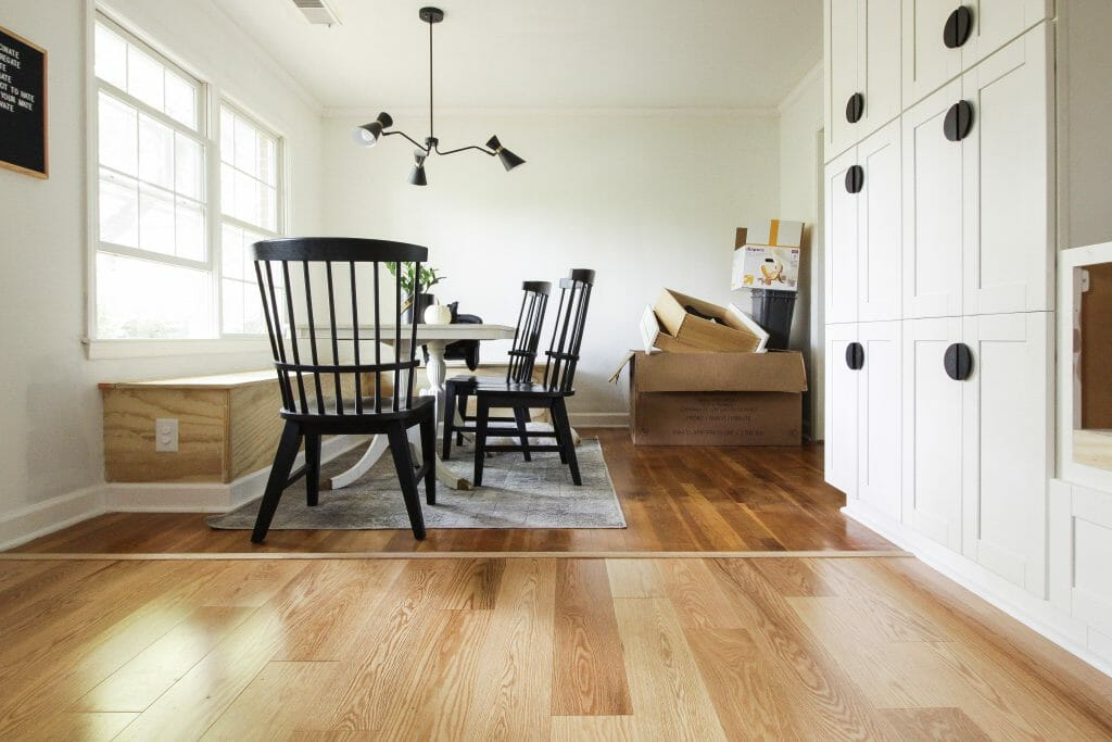 White oak hardwood flooring with Cassie Bustamante's white kitchen cabinets.