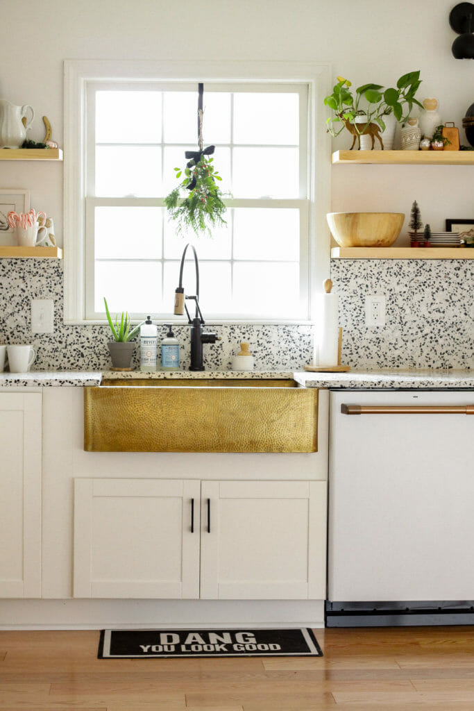 Eclectic Kitchen with brass sink