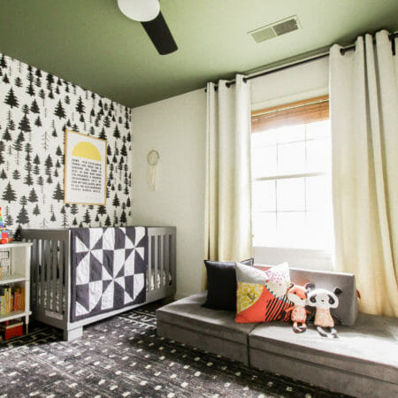 Modern Boho Nursery with Green Ceiling and Tree Wallpaper
