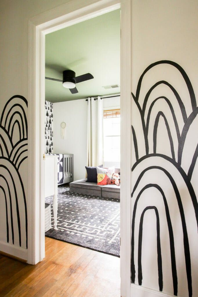 black and white patterned walls with green ceiling