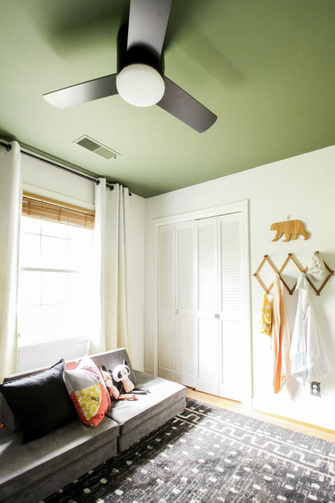 neutral nursery with green ceiling