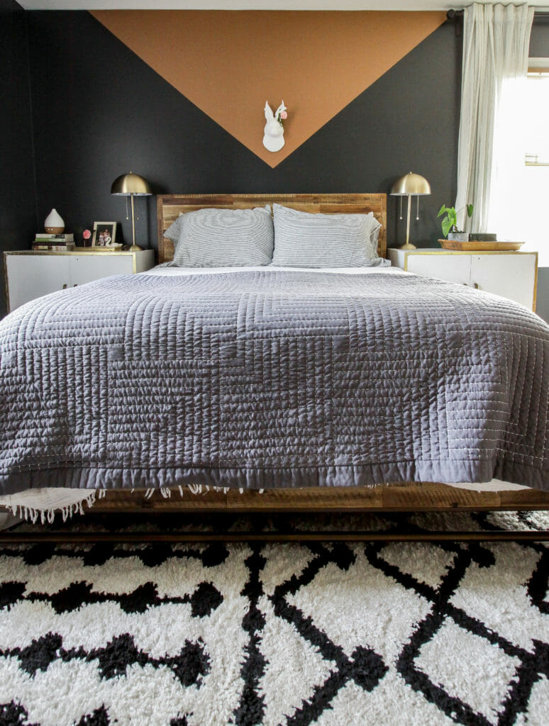 modern boho neutral bedroom with light weight gray quilt