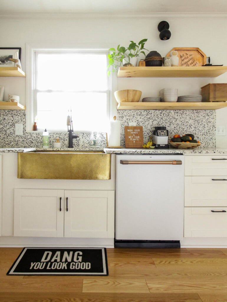 modern white kitchen with brass apron sink