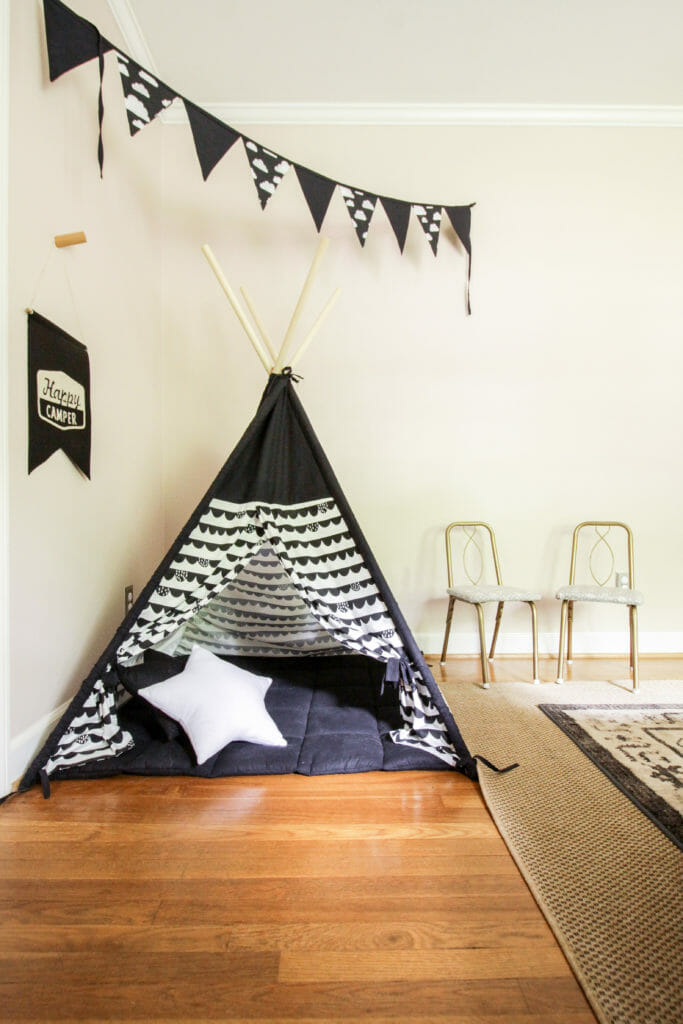 kids space with teepee and vintage chairs