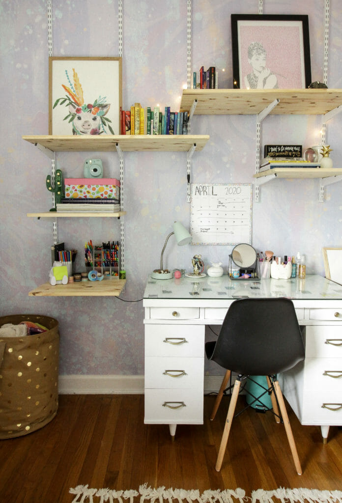 girls room with desk and track shelving