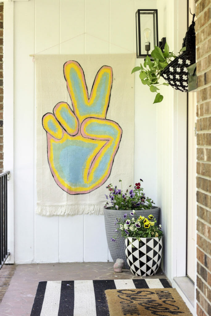 peace sign boho banner on porch with black and white and pink