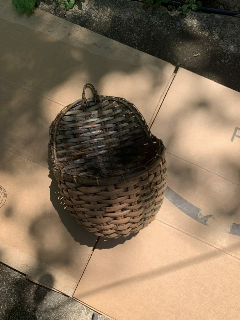 Basket on cardboard to spray paint