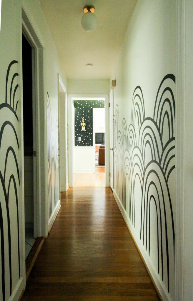 black and white rainbow mural hallway
