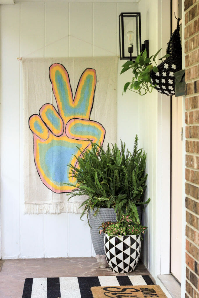 modern boho summer porch with peace sign flag