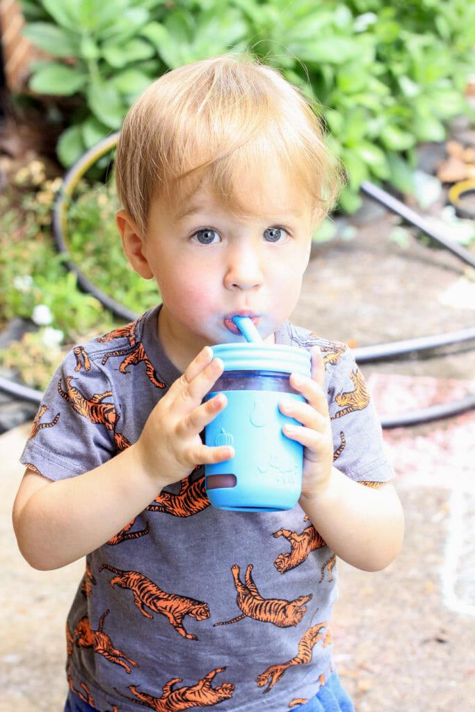 toddler with slushy drink