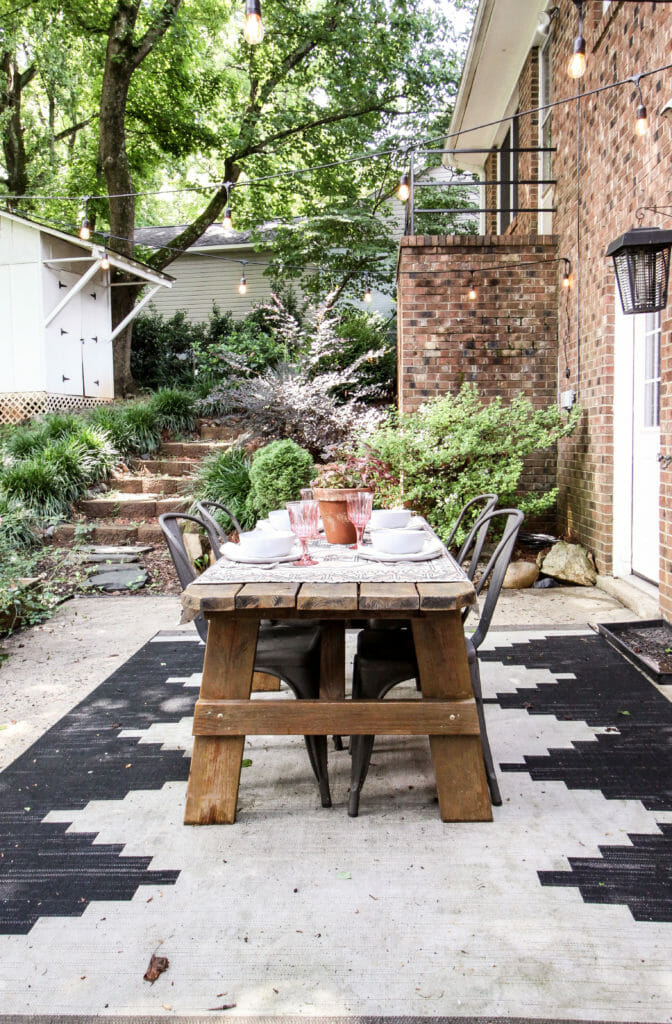 Outdoor dining space with blush