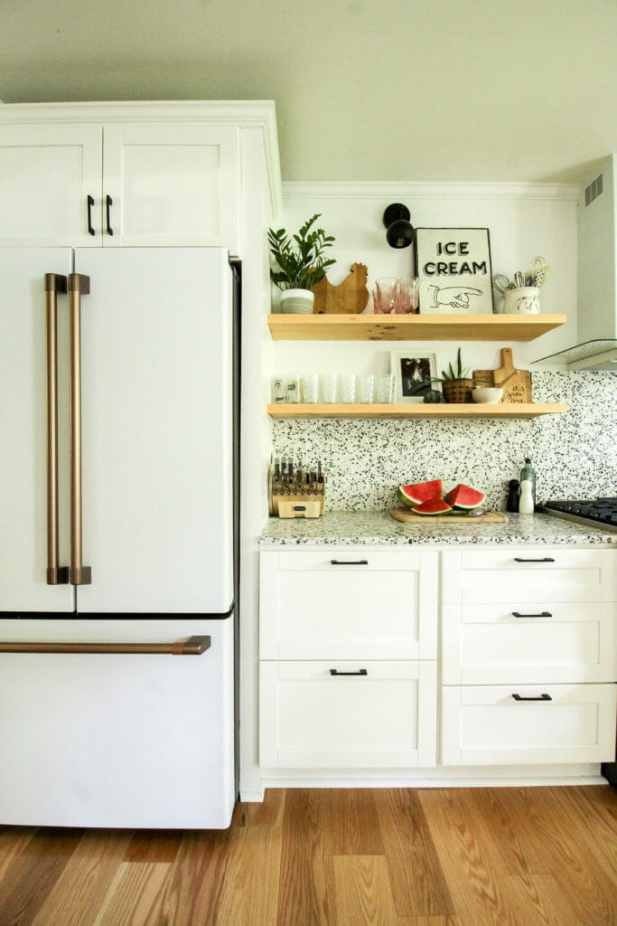 modern white and gold kitchen with watermelon