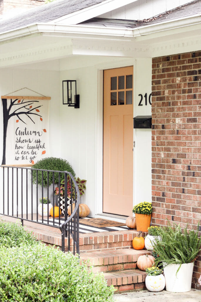 Cheerful small fall front porch