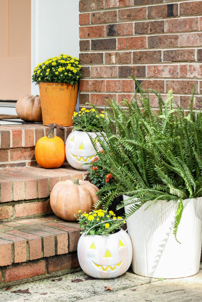 DIY painted plastic pumpkin buckets for outside