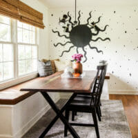 neutral dining room with sun mural