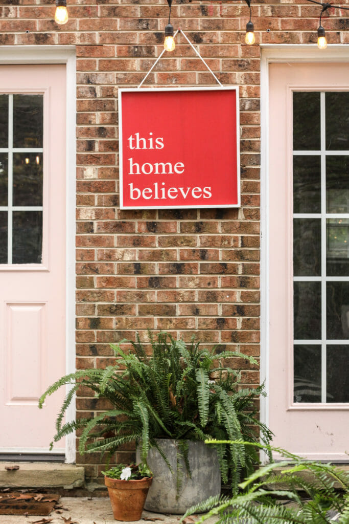 this home believes sign