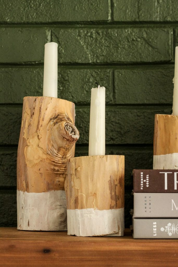 Modern boho mantel with rustic wooden candle holders