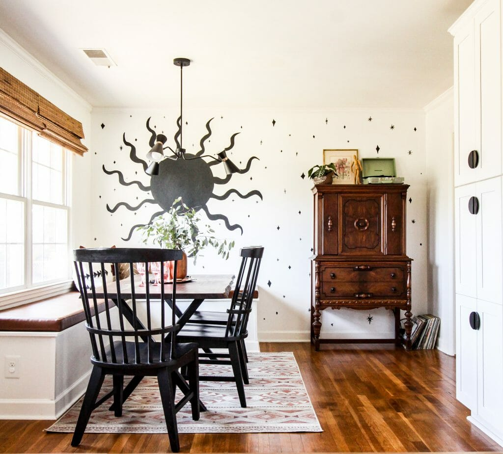 modern boho dining room with sun mural
