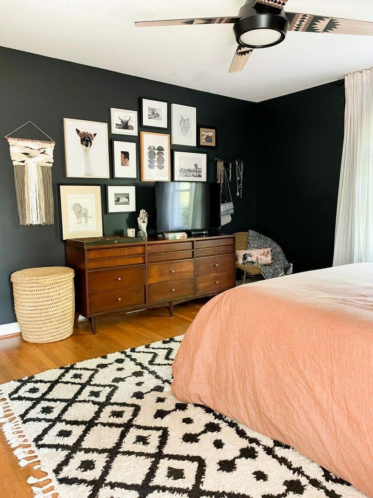 eclectic gallery wall in black bedroom