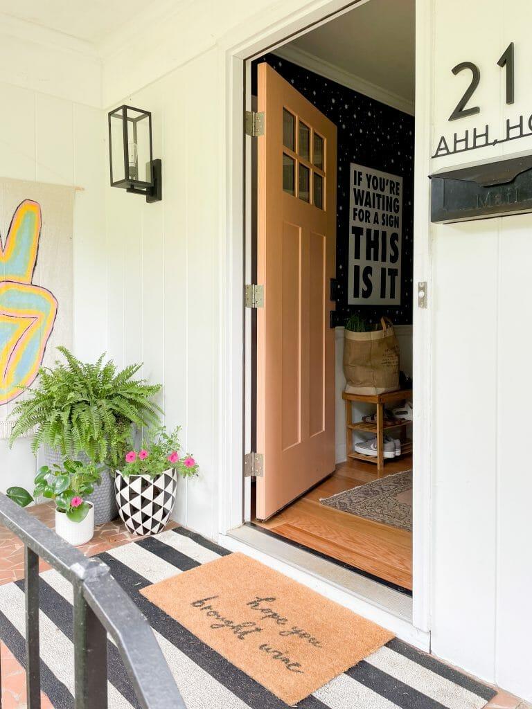 entry into home with fun orange door