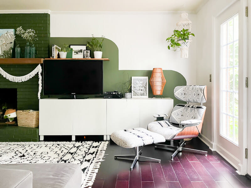 Modern boho family room in white and black, naturals and greens