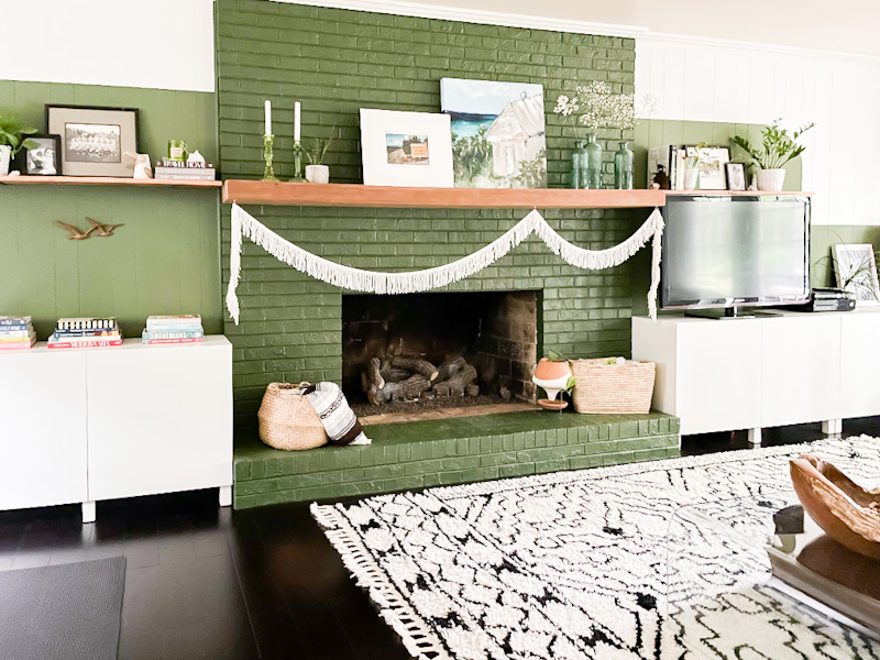 green color block wall with fireplace