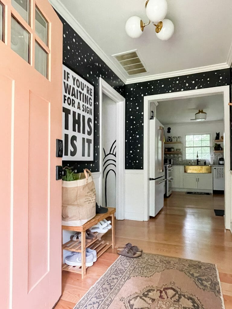 eclectic painted entry in black and white