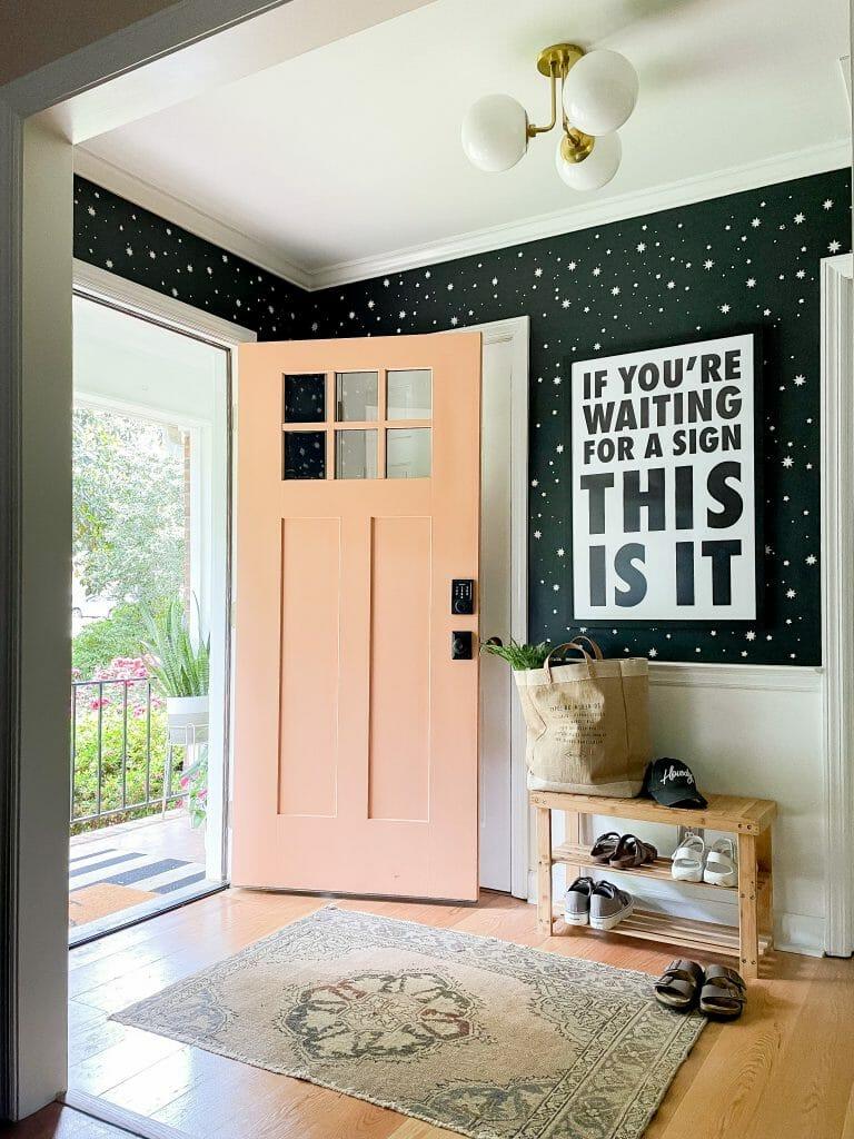 small entry with orange door