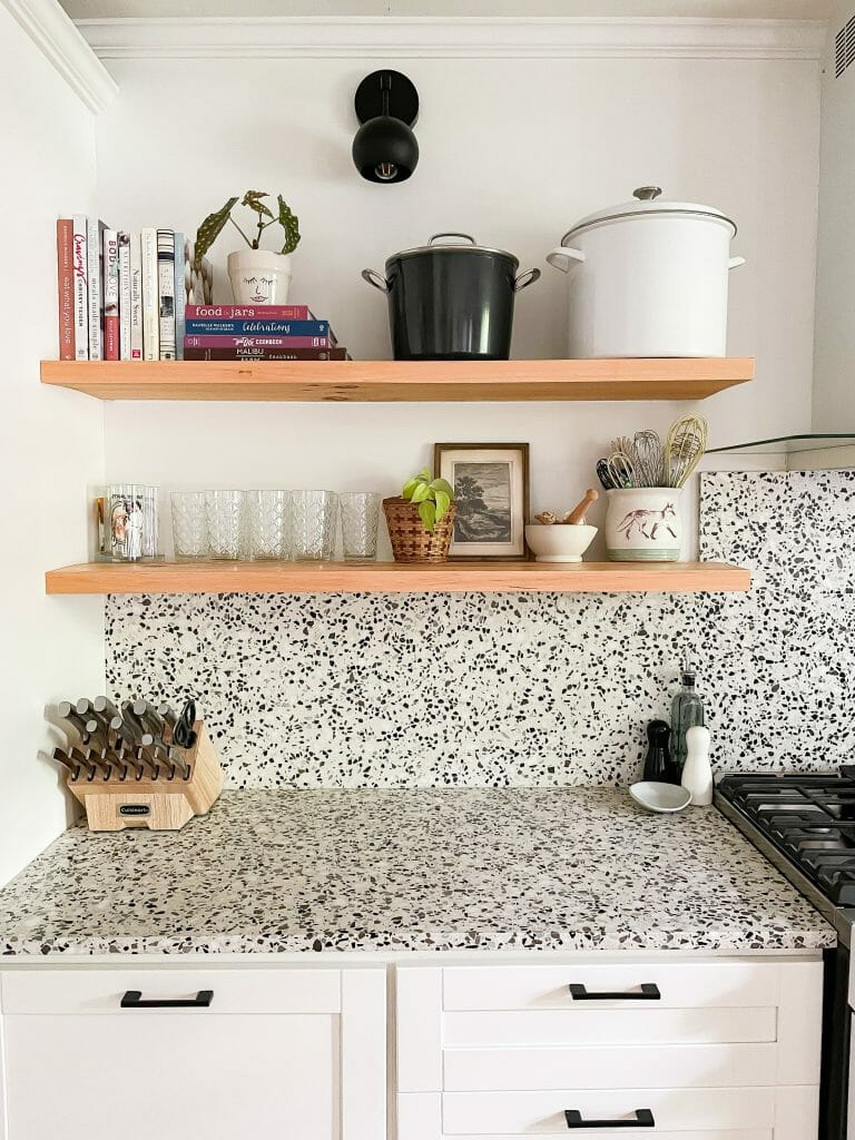kitchen with open shelving and terrazzo